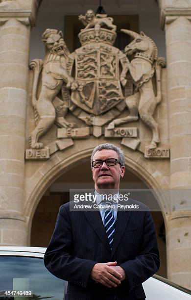 United Nations Special Adviser to the SecretaryGeneral on Cyprus Alexander Downer looks on before a press statement at the Presidential Palace on...