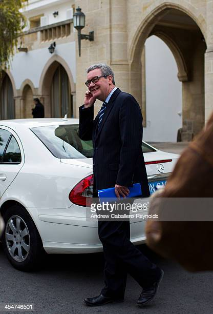 United Nations Special Adviser to the SecretaryGeneral on Cyprus Alexander Downer leaves after a meeting at the Presidential Palace on December 10...