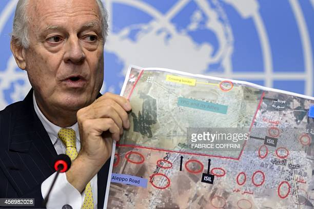 United Nations special envoy for Syria Staffan de Mistura shows a map of the Syrian town of Ain alArab known as Kobane by the Kurds during a press...