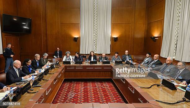United Nations special envoy Staffan de Mistura sits facing Syria's main opposition group during Syrian peace talks at the UN Offices in Geneva on...