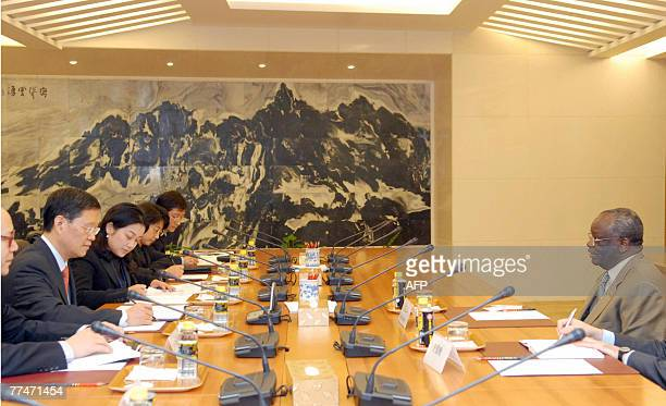 United Nations special envoy to Myanmar Ibrahim Gambari hold talks with Chinese assistant foreign minister He Yafei at the ministry of foreign...