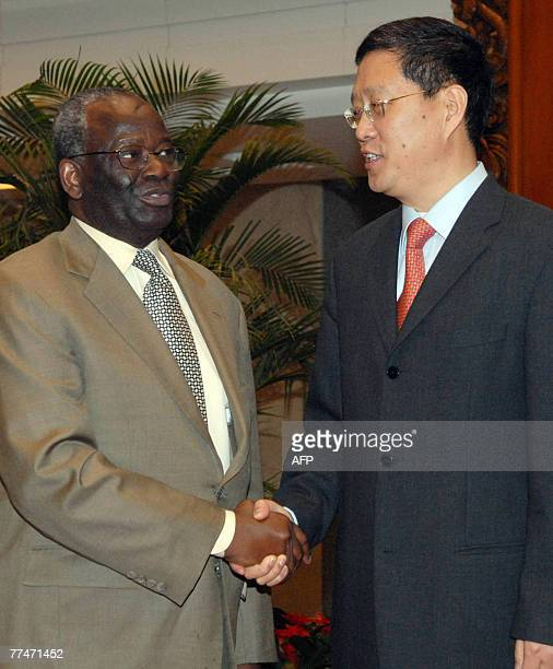 United Nations special envoy to Myanmar Ibrahim Gambari shakes hands with Chinese assistant foreign minister He Yafei at ministry of foreign affairs...