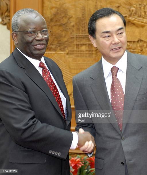 United Nations special envoy to Myanmar Ibrahim Gambari shakes hands with Vice Foreign Minister of China Wang Yi at the foreign ministry October 25...