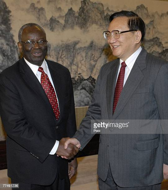 United Nations special envoy to Myanmar Ibrahim Gambari shakes hands with Chinese State Councilor Tang Jiaxuan at the Zhongnanha October 25 2007 in...