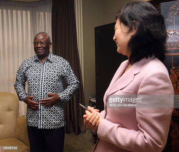 United Nations special envoy to Myanmar Ibrahim Gambari stands after an interview with AFP in Singapore 20 November 2007 Gambari said he was...
