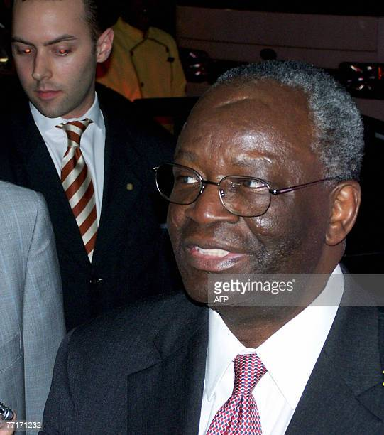 United Nations special envoy to Myanmar Ibrahim Gambari talks to reporters at his hotel in Singapore 04 October 2007 before boarding a limousine to...