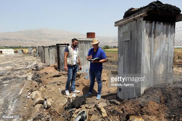 United Nations teams and Lebanese Red Cross staff carry on with infrastructure works at the Qob Elias refugee camp after a big fire broke out on...