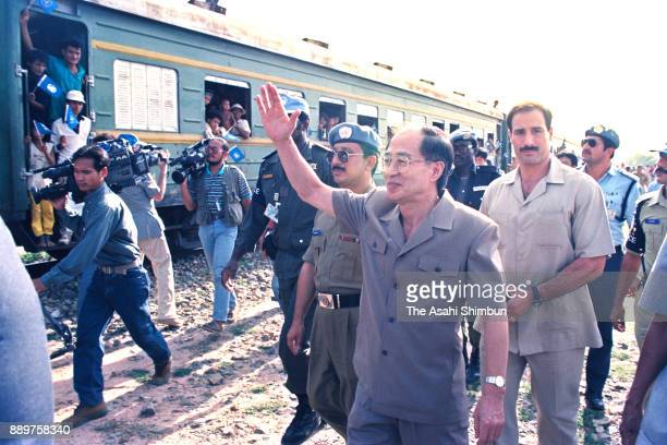 United Nations Transitional Authority in Cambodia Special Representative of the SecretaryGeneral Yasushi Akashi inspects on March 24 1993 in Phnom...