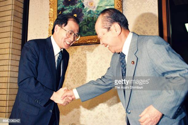 United Nations Transitional Authority in Cambodia Special Representative of the SecretaryGeneral Yasushi Akashi shakes hands with Japanese Prime...