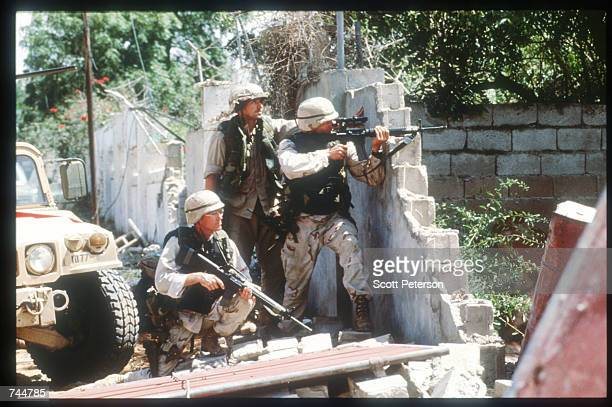 United Nations troops aim guns while on a peacekeeping mission June 20 1993 in Mogadishu Somalia An estimated 350000 Somalis died due to war famine...