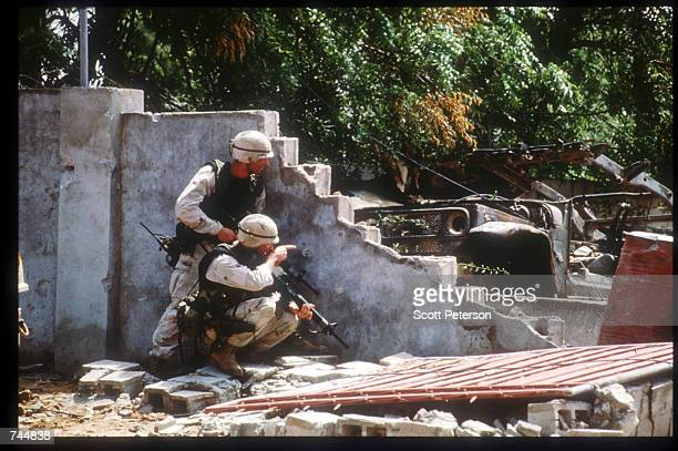 United Nations troops find protection behind a wall while on a peacekeeping mission June 20 1993 in Mogadishu Somalia An estimated 350000 Somalis...