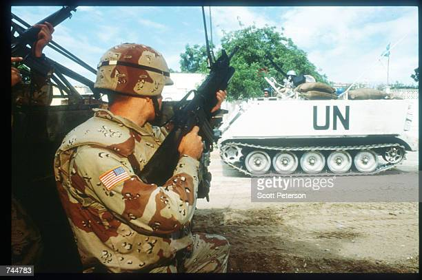 United Nations troops hold guns while on a peacekeeping mission June 20, 1993 in Mogadishu, Somalia. An estimated 350,000 Somalis died due to war,...