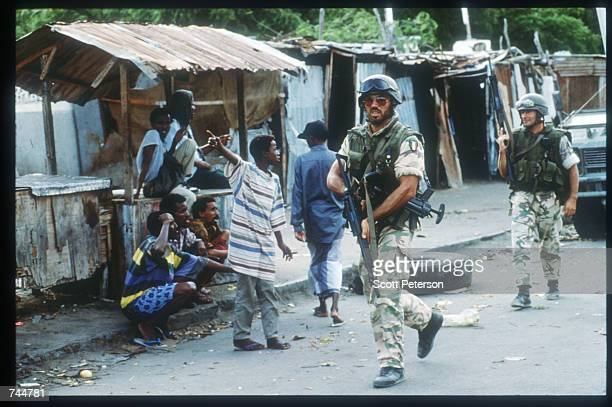 United Nations troops interact with Somalis while on a peacekeeping mission June 20 1993 in Mogadishu Somalia An estimated 350000 Somalis died due to...
