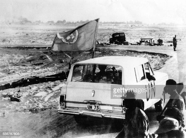 A United Nations vehicle passing Israeli troops nearQuantara on the east bank of the Suez Canal A UN observer was posted on either side of the canal...