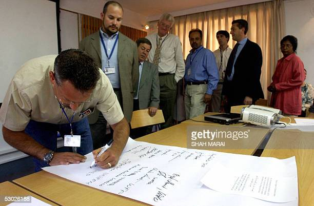 United Nations workers sign a petition in support of Italian hostage Clementina Cantoni who was kidnapped last month in the Afghan capital Kabul 06...