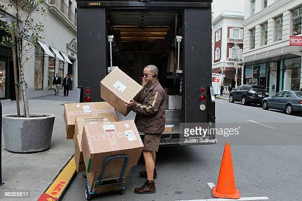 United Parcel Service driver Grant Jung loads boxes onto a handtruck as he makes deliveries February 2 2010 in San Francisco California UPS reported...