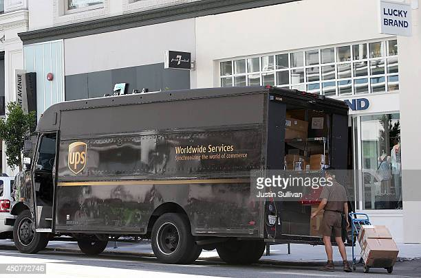 United Parcel Service driver loads a cart with boxes before making a delivery on June 17 2014 in San Francisco California UPS announced plans to...
