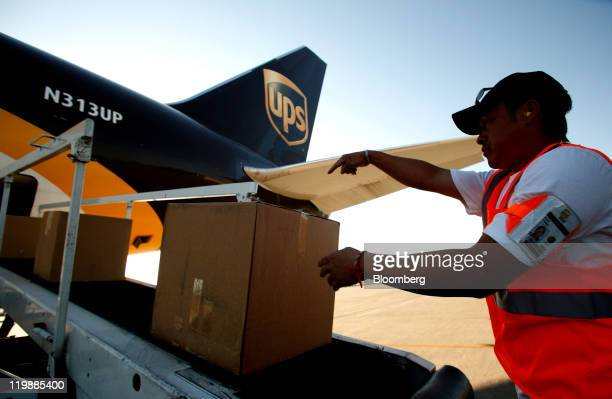 United Parcel Service Inc cargo loader Kao Yang loads parcels onto a UPS Boeing 767 jet at the UPS air hub at Mather Airport in Sacramento California...