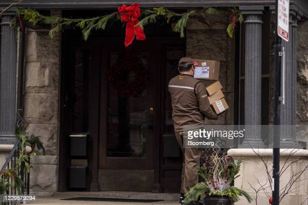 United Parcel Service Inc. Driver carries packages in the Lincoln Park neighborhood of Chicago, Illinois, U.S., on Monday, Nov. 30, 2020. Online...