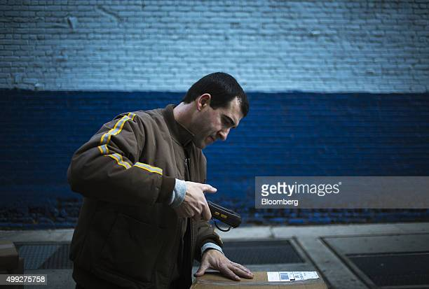 A United Parcel Service Inc driver scans a package for delivery on Cyber Monday in New York US on Monday Nov 30 2015 Online sales on Cyber Monday may...
