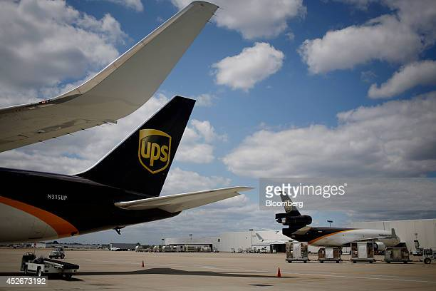 United Parcel Service Inc jet freighters sit on the tarmac while being loaded with outbound packages during the afternoon sort at the UPS Worldport...