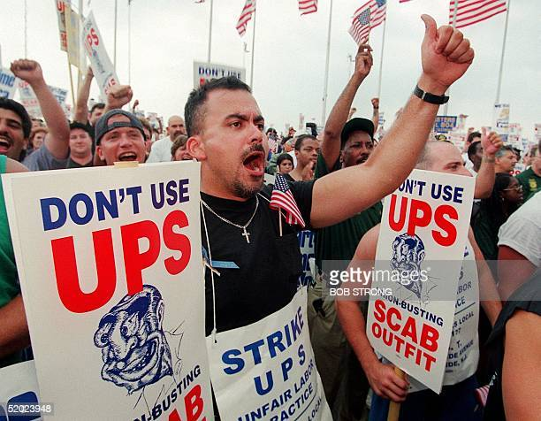 United Parcel Service worker Roberto Martinez shouts his support for striking Teamsters union members at a rally in Liberty State Park in Jersey...