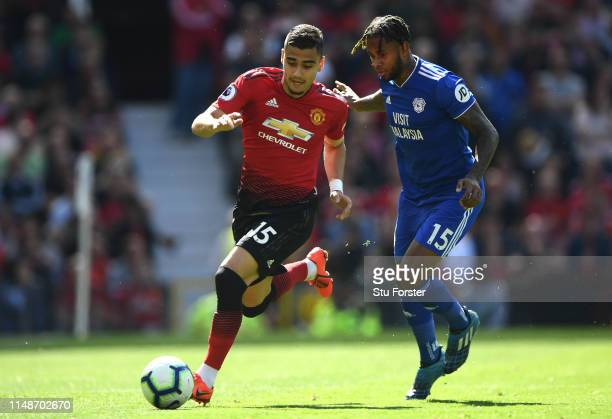 United player Andreas Pereira holds off the challenge of Leandro Bacuna during the Premier League match between Manchester United and Cardiff City at...