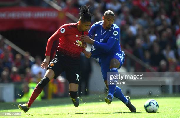 United player Chris Smalling challenges Kenneth Zohore of Cardiff during the Premier League match between Manchester United and Cardiff City at Old...