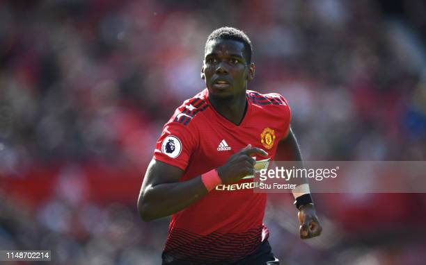 United player Paul Pogba in action during the Premier League match between Manchester United and Cardiff City at Old Trafford on May 12, 2019 in...