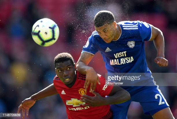 United player Paul Pogba is beaten to the ball by Cardiff player Lee Peltier during the Premier League match between Manchester United and Cardiff...