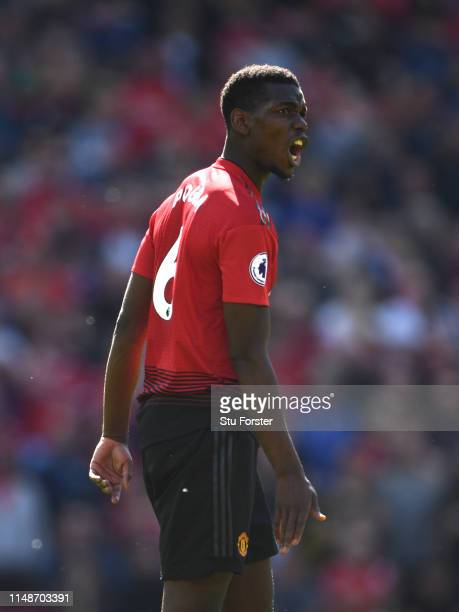 United player Paul Pogba reacts during the Premier League match between Manchester United and Cardiff City at Old Trafford on May 12, 2019 in...