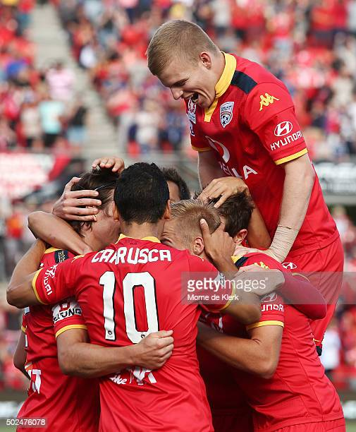 United players celebrate a goal by Michal Marrone during the round 12 ALeague match between Adelaide United and the Wellington Phoenix at Coopers...