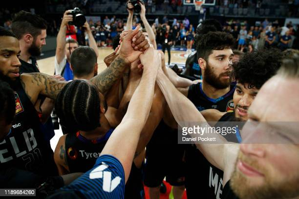 United players celebrate after winning the round 8 NBL match between Melbourne United and the Brisbane Bullets at Melbourne Arena on November 24,...