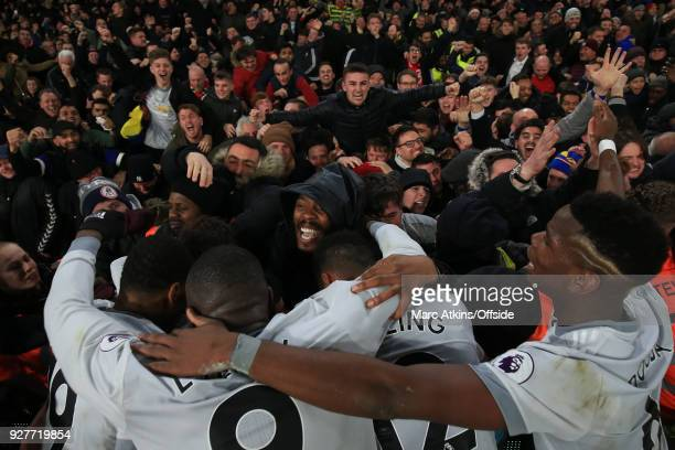 United players celebrate the late winner from Nemanja Matic with the fans during the Premier League match between Crystal Palace and Manchester...