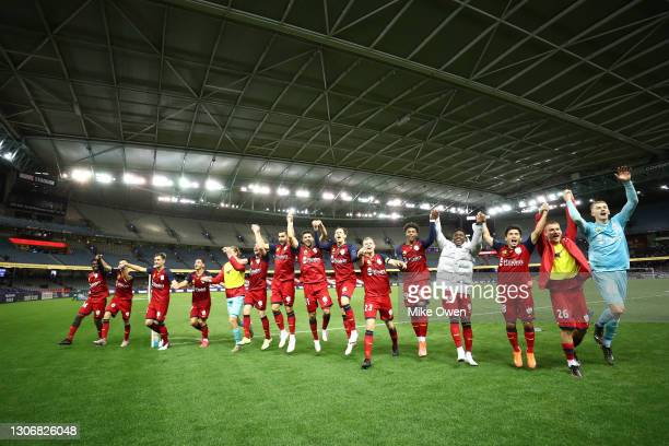 United players celebrate to their fans after winning the A-League match between the Melbourne Victory and Adelaide United at Marvel Stadium, on March...