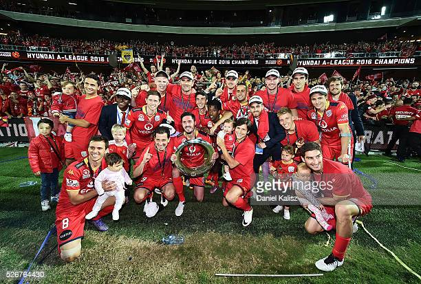 United players pose for a photo in front of their supporters after the 2015/16 A-League Grand Final match between Adelaide United and the Western...