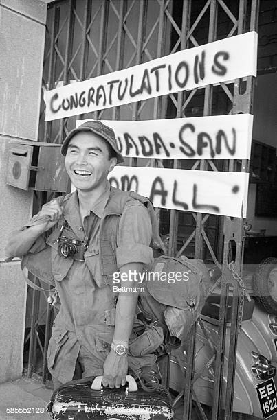 United Press International photographer Kyoichi Sawada wears a big grin after viewing a congratulatory sign posted outside the UPI bureau upon his...