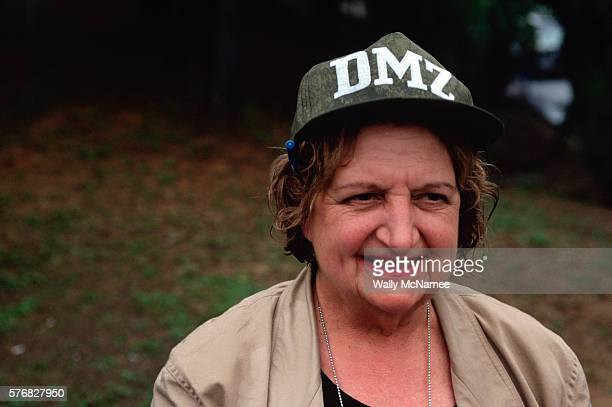 United Press International White House reporter Helen Thomas grins impishly at the camera while visiting the American sector of the Demilitarized...