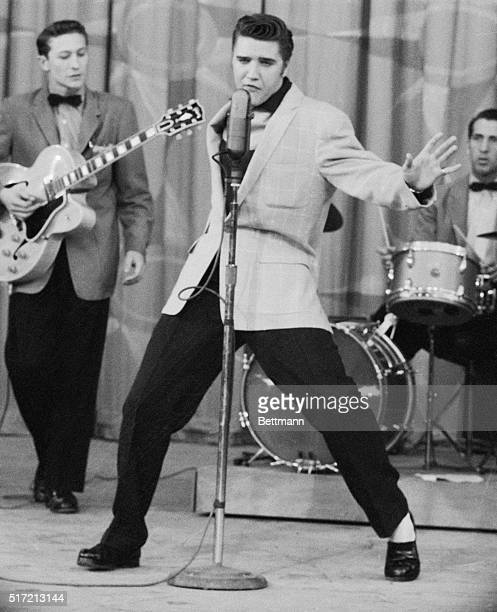 United Press photo by staff photographer Stewart Sawyer made in Hollywood may throw some light on the wildest exponent of rock and roll Here is Elvis...