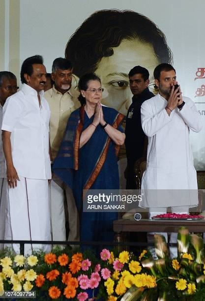 United Progressive Alliance chairperson Sonia Gandhi gestures next to All India Congress Committee President Rahul Gandhi and Dravida Munnettra...