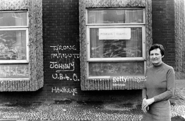 United Reform minister Patricia Parrish looks at some of the graffiti on the walls at her chapel on the Penrhys Estate The chapel is a corner room in...