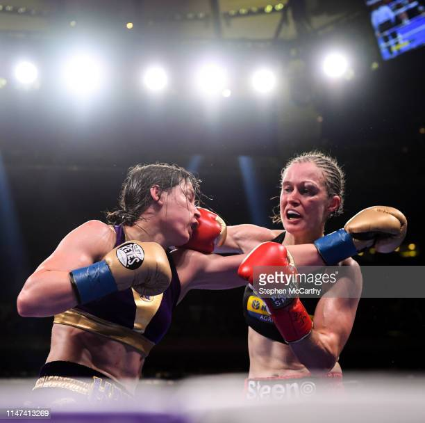 United States - 1 June 2019; Katie Taylor, left, and Delfine Persoon during their Undisputed Female World Lightweight Championship fight at Madison...