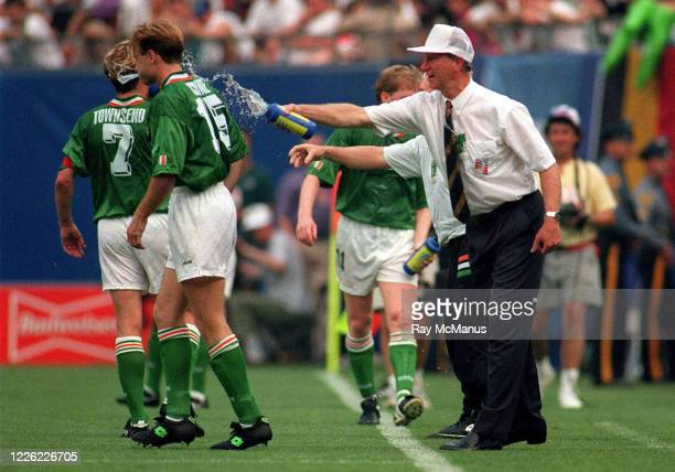 NJ United States 18 June 1994 Republic of Ireland manager Jack Charlton splashes water on Tommy Coyne and Andy Townsend during the FIFA World Cup...