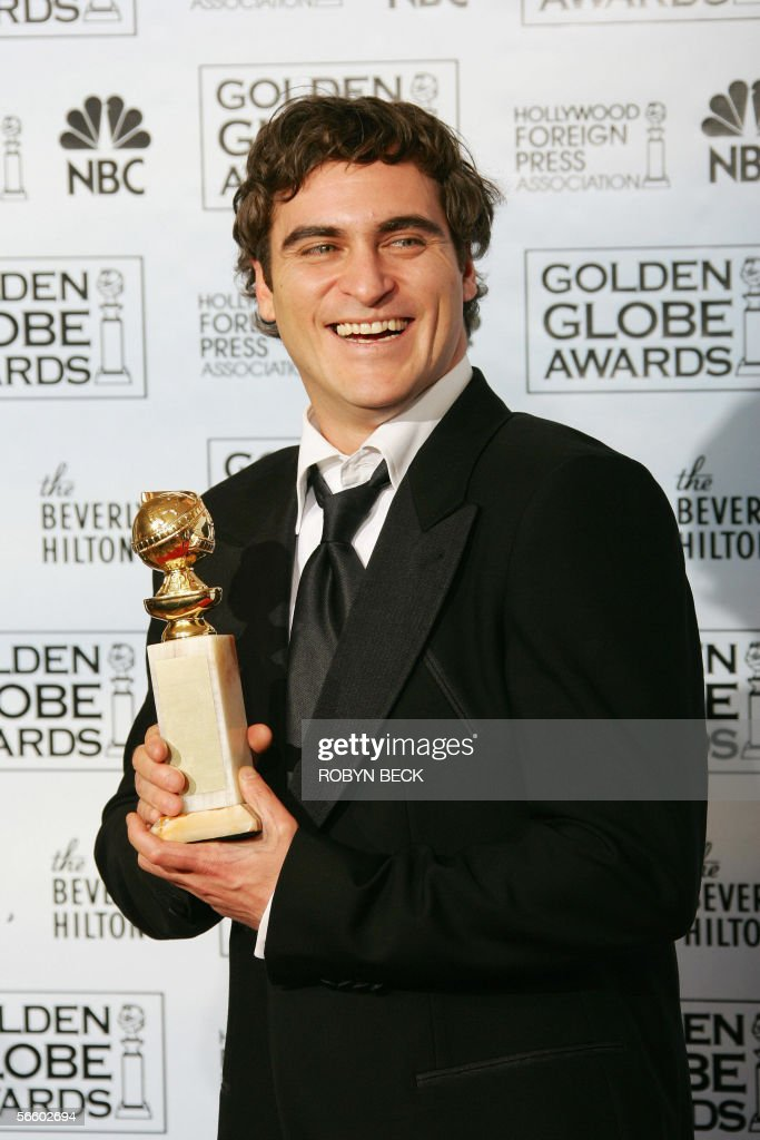 Actor Joaquin Phoenix  pose with his tro : News Photo
