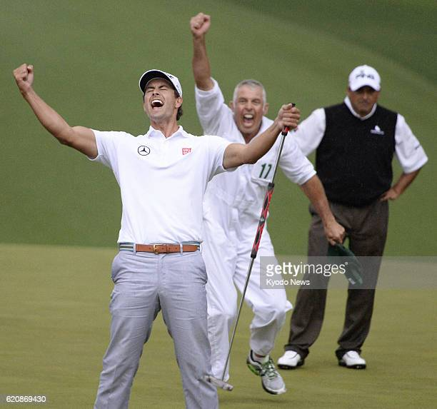 AUGUSTA United States Adam Scott of Australia celebrates after winning a playoff against Angel Cabrera of Argentina to capture his first major title...