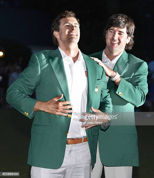 AUGUSTA United States Adam Scott of Australia smiles after having a green jacket put on by Bubba Watson of the United States the winner of the 2012...
