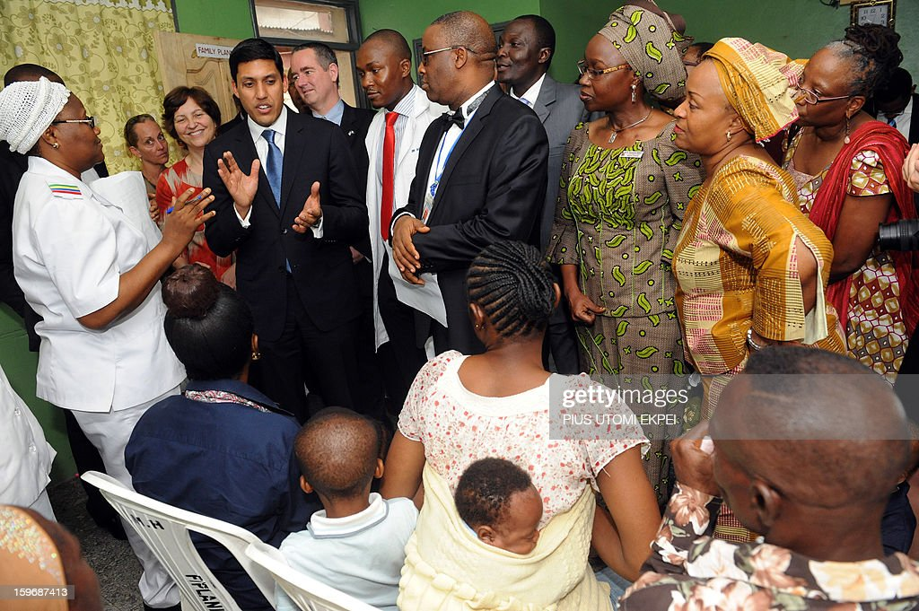 United States Agency for International Development (USAID) Adminstrator Rajiv Shah (2nd L) speaks to mothers at the family planning unit of Lagos Island Maternity Hospital during an inspection of health facilities sponsored by the agency in Lagos on January 18, 2013. Shah is in Nigeria to meet with senior government officials to further USAID's collaboration with the government. He will also meet with leaders in private sector to discuss new opportunities for partnerships that can accelerate growth and development.
