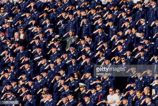 United States Air Force Academy cadets salute before the NCAA Division 1-A Army-Air Force college football game on 5th November 1994 at the Michie...