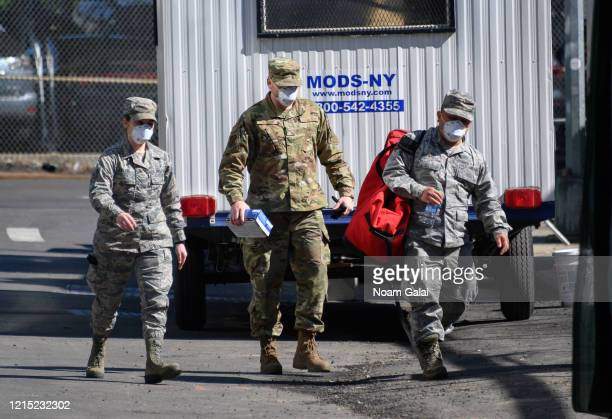 United States Air Force airmen help build a makeshift morgue outside of Bellevue Hospital to handle an expected surge in coronavirus victims on March...