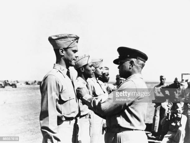 United States Air Force Brigadier General Benjamin O Davis Sr pins the Distinguished Flying Cross to his son Colonel Benjamin O Davis Jr of the 332nd...